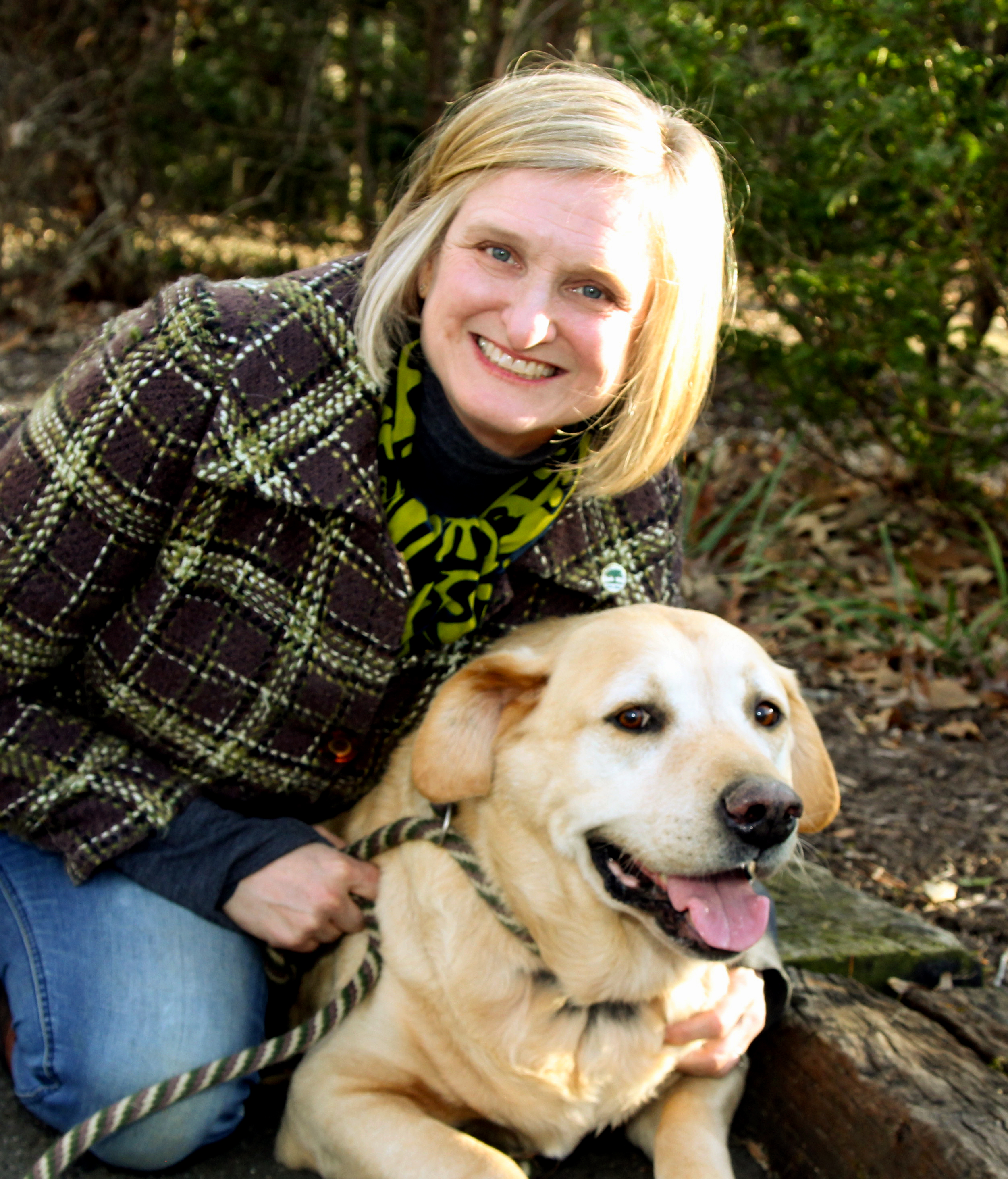 Sara with Bruce one of her nine dogs